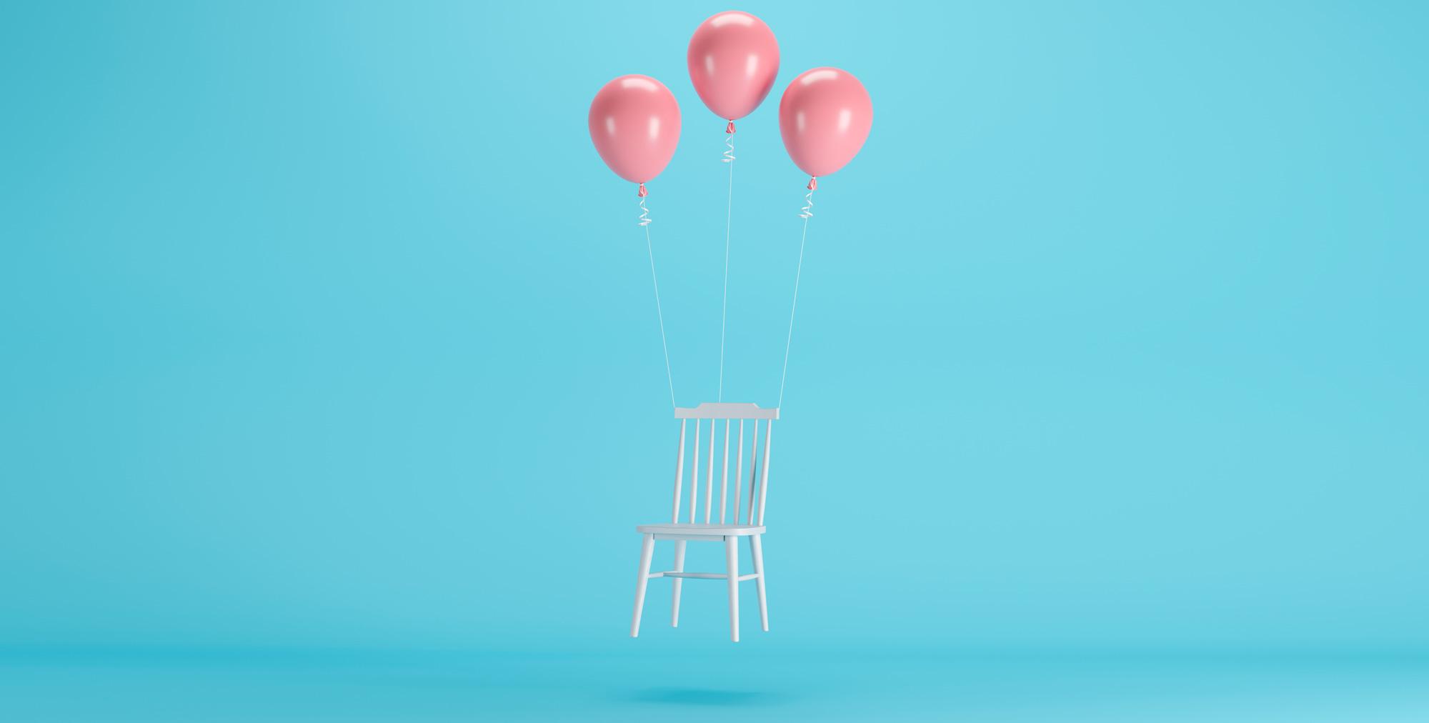 Globos elevando silla